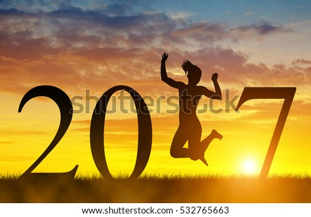 Girls jump up in celebration of the New Year 2017.