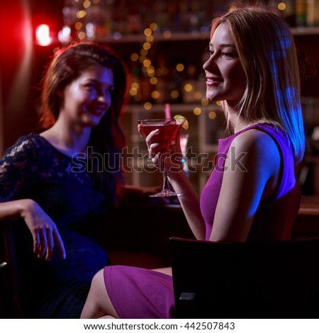 Girls relaxing in night club after work