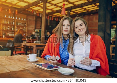 girls use their break from work to drink coffee and chat