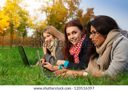 Girls using wifi internet in college park