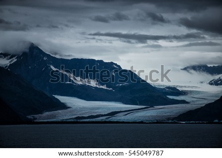 Glacier in Alaska on an overcast day at dusk.