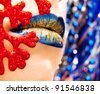 Glamour Blue Gold gloss lips moving up on bright blue background, shallow focus - stock photo
