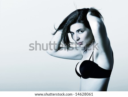 Glamour Portrait of a beautiful young woman - toned in blue