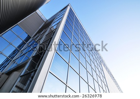 glass and metal structure of a business building as seen by an ultra wide lens