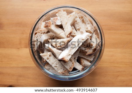 glass bowl with bread crumbs on a wooden table