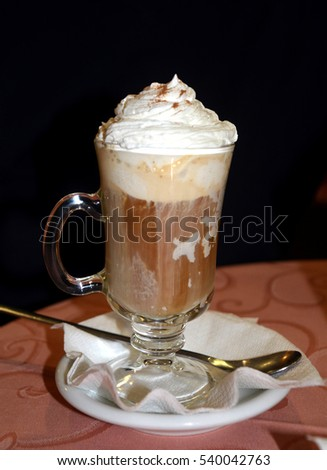 Glass cup of coffee with ice cream and whipped cream