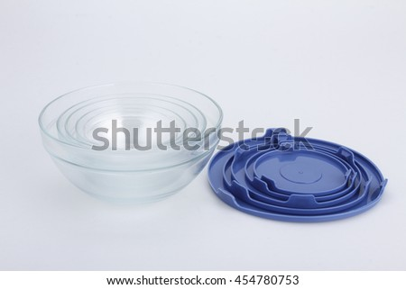 glass food container with blue plastic lid isolated on white background