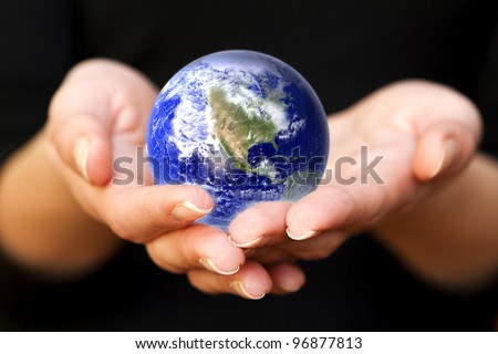 glass globe in hand. Elements of this image furnished by NASA