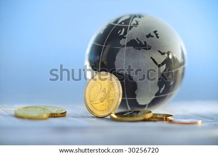 Glass globe with Europe and Africa showing and Euros