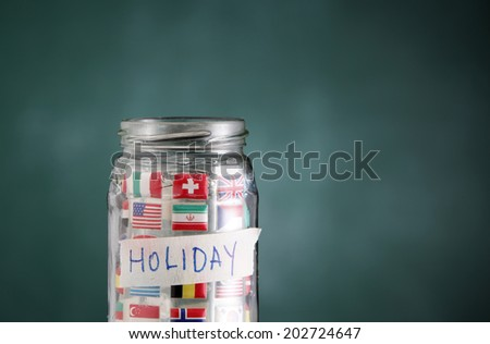 glass jar filled up with international flags