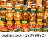 glass jars with nuts and honey on counter in a market as the background - stock photo