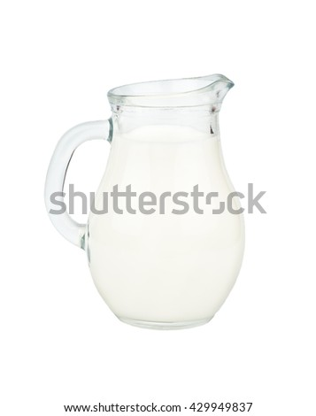Glass jug filled with milk isolated on white background