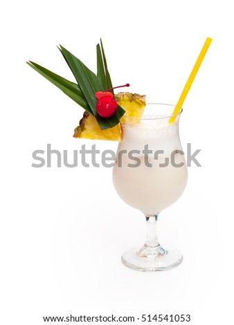 Glass of alcoholic white drink with pineapple, cherry and ice on white background.