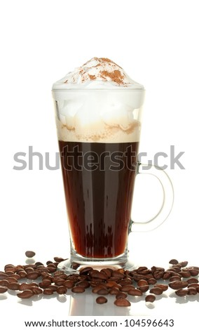 glass of coffee cocktail with coffee beans on white background close-up
