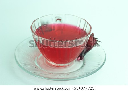 Glass of cold roselle juice - healthy food against wood