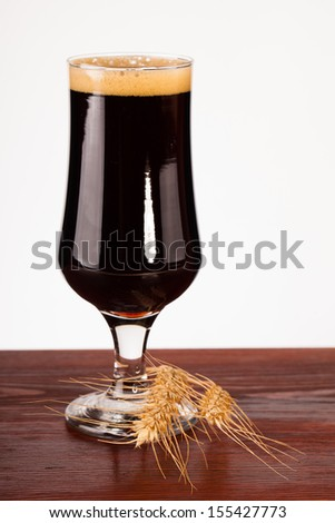 glass of dark beer on table