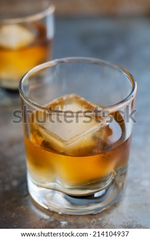 Glass of delicious aged single malt scotch on the rocks