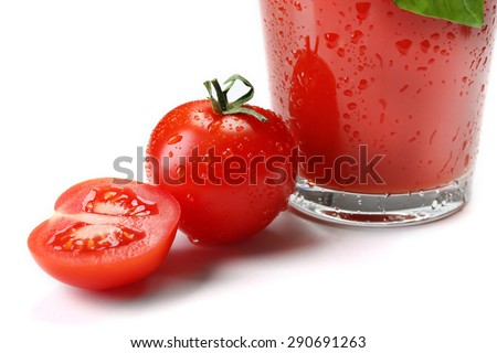 Glass of fresh tomato juice isolated on white
