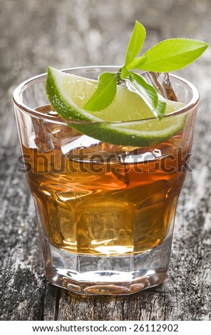 glass of ice tea with lime close up shoot