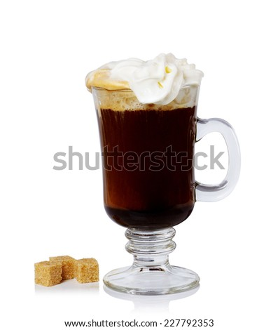 glass of Irish coffee and sugar cane on a white background.