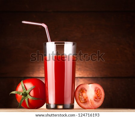 glass of tomato juice with pipe