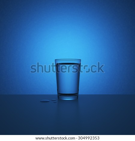 Glass of water spot light on background