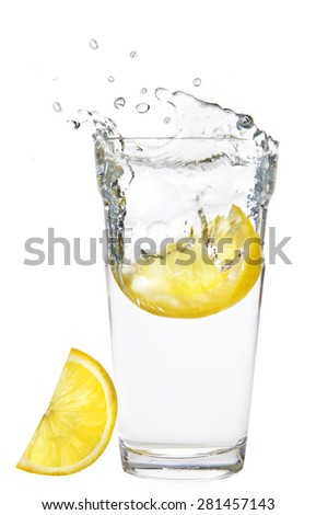 glass of water with lemon on a white background