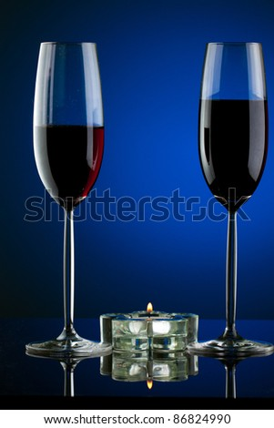 Glass of wine in studio on blue background