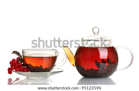 Glass teapot and cup with black tea and viburnum isolated on white