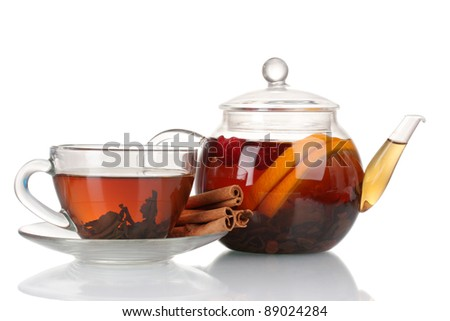 Glass teapot and cup with black tea of orange, cinnamon isolated on white