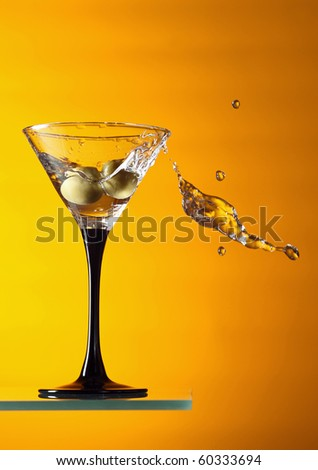 glass with martini on a orange background.