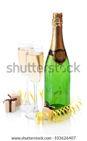 glasses and bottle of champagne, gifts and serpentine isolated on a white