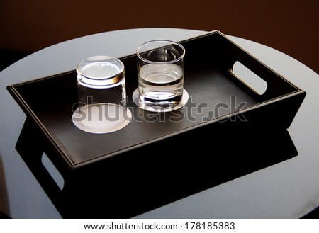 glasses in tray on table