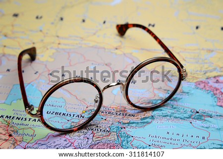 Glasses on a map of Asia - Uzbekistan