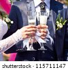 Glasses with champagne in hands newlyweds - stock photo