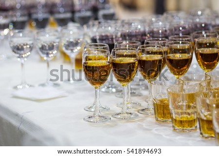 glasses with juice, champagne glasses, glasses with wine,catering banquet table, catering, stemware,red wine,whiskey