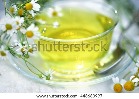 Glassy Cup of herbal tea with camomile