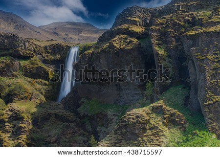 Gljufrabui (Canyon dweller) waterfall. A waterfall that falls in a hidden narrow gorge along the former (glacial period) coastline of. Southern Iceland