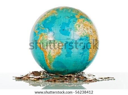 Globe on the pile of coins - isolated
