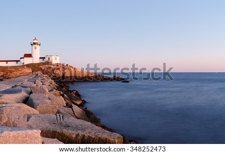 Gloucester, Massachusetts - December 5, 2015: Eastern Point Lighthouse at Gloucester at Sunset, Massachusetts, USA. The Lighthouse is One of Five iconic lighthouses along the Cape Ann coastline.