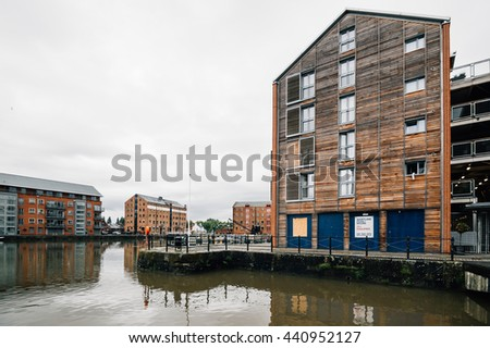 Gloucester, UK - August 14, 2015:  Gloucester Docks at sunset a cloudy day. New housing development.