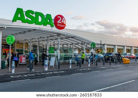 GLOUCESTER, UK - DECEMBER 07: unidentified people passing by Asda supermarket on December 07, 2011 in Gloucester, UK. Asda is the UK's second-largest chain by market share, with over 175,000 employees