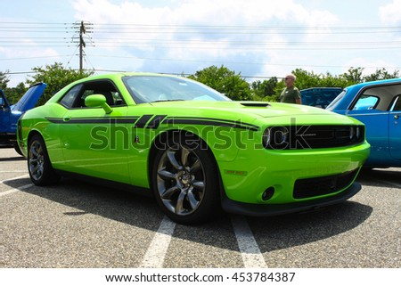 GLOUCESTER, VA - JULY 9, 2016: A lime green Dodge Challenger 6.4 RT at the Collector Car Appreciation Day Car Show sponsored by the Middle Peninsula Classic Cruisers car club.