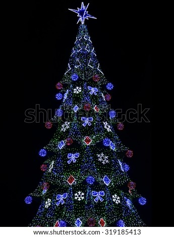 glowing colorful electronic Christmas Tree over black (diode type)