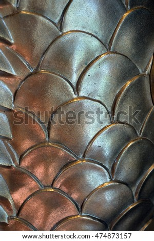 Glowing metallic fish-like scales brightly lit by natural sunlight
