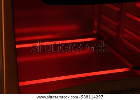 Glowing red heating elements in electric oven