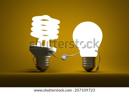 Glowing spiral light bulb character and tungsten one handshaking on dark yellow textured background