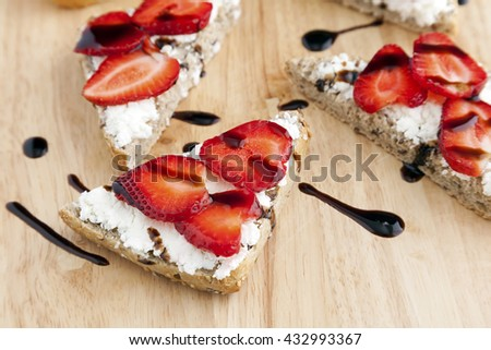 Goat's cheese and strawberry bruschetta with drizzle of balsamic cream.