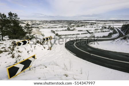 Goathland, Yorkshire, UK. The A169 motorway flanked by the North York Moors covered in snow on a winter morning near Goathland, Yorkshire, UK.