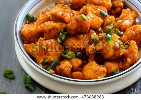 Gobi Manchurian - A popular Indo Chinese Street food with cauliflower florets, selective focus